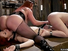 Mistress whipping two big ass lesbians