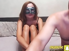 Husband in mask show thebody of his wife