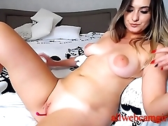Mom on a webcam masturbates with a toy