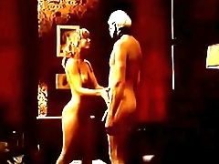 Nina Hartley fucks a man in a skull mask