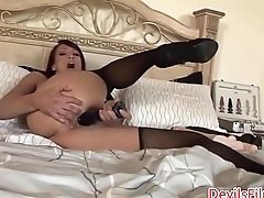 Redhead MILF pleasing herself with dildos