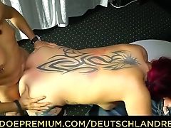DEUTSCHLAND REPORT - Tattooed redhead in her 40s sucks dick and rides it for amateur German porn